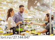 Купить «couple buying food at grocery store cash register», фото № 27144847, снято 21 октября 2016 г. (c) Syda Productions / Фотобанк Лори