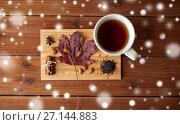 Купить «cup of tea, maple leaf and almond on wooden board», фото № 27144883, снято 13 октября 2016 г. (c) Syda Productions / Фотобанк Лори