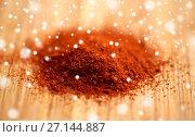 Купить «cayenne pepper or paprika powder on wood», фото № 27144887, снято 13 октября 2016 г. (c) Syda Productions / Фотобанк Лори