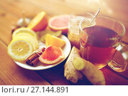 Купить «ginger tea with honey, citrus and cinnamon on wood», фото № 27144891, снято 13 октября 2016 г. (c) Syda Productions / Фотобанк Лори