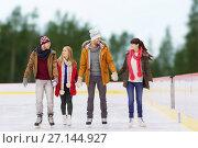 Купить «friends holding hands on outdoor skating rink», фото № 27144927, снято 26 ноября 2014 г. (c) Syda Productions / Фотобанк Лори