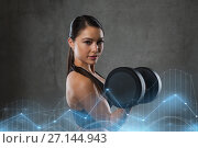 Купить «young woman flexing muscles with dumbbells in gym», фото № 27144943, снято 12 декабря 2015 г. (c) Syda Productions / Фотобанк Лори