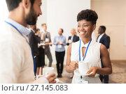 Купить «business people with conference badges and coffee», фото № 27145083, снято 27 августа 2017 г. (c) Syda Productions / Фотобанк Лори