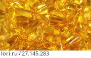 Купить «cod liver oil capsules», видеоролик № 27145283, снято 6 октября 2017 г. (c) Syda Productions / Фотобанк Лори