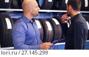 customer and salesman at car service or auto store. Стоковое видео, видеограф Syda Productions / Фотобанк Лори