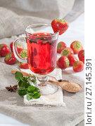 Купить «A cup of freshly brewed strawberry tea with fresh mint.», фото № 27145391, снято 20 октября 2017 г. (c) Olesya Tseytlin / Фотобанк Лори