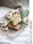 Купить «Three pieces of freshly baked baguette on a wooden board and fresh herbs.», фото № 27145431, снято 16 октября 2017 г. (c) Olesya Tseytlin / Фотобанк Лори
