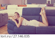 Купить «Nice woman lying barefoot on sofa with pillow», фото № 27146035, снято 5 сентября 2017 г. (c) Яков Филимонов / Фотобанк Лори