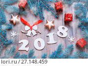 Купить «Happy New Year 2018 background with 2018 figures, Christmas toys, blue fir tree branches and snowflakes. New Year 2018 still life», фото № 27148459, снято 29 ноября 2016 г. (c) Зезелина Марина / Фотобанк Лори