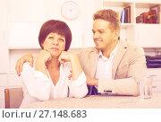 Купить «Mother and son sit at table», фото № 27148683, снято 16 августа 2018 г. (c) Яков Филимонов / Фотобанк Лори