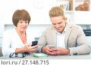 Купить «Mother and son with smartphones», фото № 27148715, снято 8 июля 2020 г. (c) Яков Филимонов / Фотобанк Лори