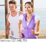 Купить «Couple running on beach by sea», фото № 27148751, снято 16 октября 2019 г. (c) Яков Филимонов / Фотобанк Лори