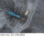 Купить «Open pit mine, breed sorting. Mining coal. Bulldozer sorts coal. Extractive industry, anthracite. Crushing marshalling complex. Coal industry.», фото № 27150843, снято 8 сентября 2017 г. (c) Сергей Тимофеев / Фотобанк Лори