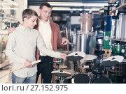 Купить «Boy and father choosing best drum», фото № 27152975, снято 29 марта 2017 г. (c) Яков Филимонов / Фотобанк Лори