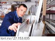 Купить «Professional labour with finished PVC profiles and windows at factory», фото № 27153035, снято 30 марта 2017 г. (c) Яков Филимонов / Фотобанк Лори