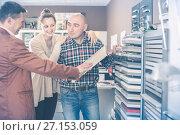 Купить «Cheerful adult customers choosing kitchen facade», фото № 27153059, снято 4 апреля 2017 г. (c) Яков Филимонов / Фотобанк Лори