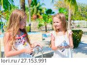 Купить «Adorable little girls with small turtles in hands in the natural reserve», фото № 27153991, снято 10 апреля 2017 г. (c) Дмитрий Травников / Фотобанк Лори