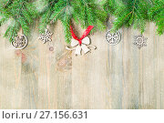 Купить «New Year and Christmas background. Christmas toys, green fir tree on the wooden background. New Year still life», фото № 27156631, снято 8 мая 2017 г. (c) Зезелина Марина / Фотобанк Лори