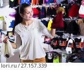 Купить «Woman choosing new knit cap», фото № 27157339, снято 22 ноября 2016 г. (c) Яков Филимонов / Фотобанк Лори
