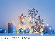Купить «Christmas decoration with candles on background white wall», фото № 27161519, снято 28 октября 2017 г. (c) Майя Крученкова / Фотобанк Лори