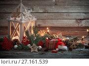Купить «Christmas decoration with white lantern on wooden background», фото № 27161539, снято 28 октября 2017 г. (c) Майя Крученкова / Фотобанк Лори