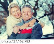 Купить «Smiling mature couple relaxing in park», фото № 27162783, снято 19 октября 2018 г. (c) Яков Филимонов / Фотобанк Лори