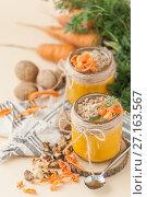 Купить «Two jars of carrot pudding with a walnut on a light peach background.», фото № 27163567, снято 31 октября 2017 г. (c) Olesya Tseytlin / Фотобанк Лори