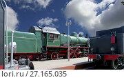 Купить «Ancient steam locomotive, Moscow museum of railway in Russia, Rizhsky railway station (Rizhsky vokzal, Riga station)», видеоролик № 27165035, снято 24 октября 2017 г. (c) Владимир Журавлев / Фотобанк Лори