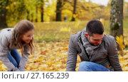 Купить «happy family playing with autumn leaves at park», видеоролик № 27165239, снято 18 ноября 2017 г. (c) Syda Productions / Фотобанк Лори