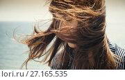 Купить «Woman relaxing while wind blowing through her hair», видеоролик № 27165535, снято 1 ноября 2017 г. (c) Илья Шаматура / Фотобанк Лори