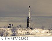 Купить «Oil field. Drilling rig and oil pump.», фото № 27165635, снято 1 ноября 2015 г. (c) bashta / Фотобанк Лори