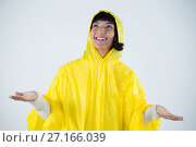 Купить «Woman in yellow raincoat gesturing to feel the rain», фото № 27166039, снято 25 августа 2017 г. (c) Wavebreak Media / Фотобанк Лори