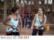 Купить «Female friends getting their belt tied to perform zip line», фото № 27166683, снято 9 мая 2017 г. (c) Wavebreak Media / Фотобанк Лори