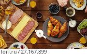 Купить «group of people eating at table with food», видеоролик № 27167899, снято 23 апреля 2019 г. (c) Syda Productions / Фотобанк Лори