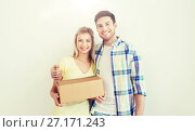 Купить «smiling couple with box moving to new home», фото № 27171243, снято 25 февраля 2016 г. (c) Syda Productions / Фотобанк Лори