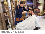 Купить «man and barber with trimmer cutting hair at salon», фото № 27171335, снято 6 апреля 2017 г. (c) Syda Productions / Фотобанк Лори