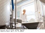 Купить «woman working at ice cream factory conveyor», фото № 27171367, снято 17 июля 2017 г. (c) Syda Productions / Фотобанк Лори