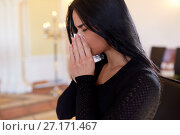 Купить «close up of crying woman at funeral in church», фото № 27171467, снято 20 марта 2017 г. (c) Syda Productions / Фотобанк Лори