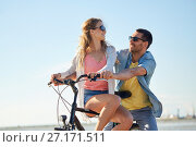 Купить «happy young couple riding bicycle at seaside», фото № 27171511, снято 23 июля 2017 г. (c) Syda Productions / Фотобанк Лори