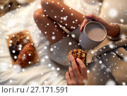 Купить «close up of woman with cocoa cup and cookie in bed», фото № 27171591, снято 15 октября 2016 г. (c) Syda Productions / Фотобанк Лори