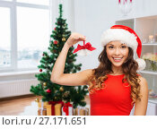 Купить «woman in santa helper hat with jingle bells», фото № 27171651, снято 22 сентября 2013 г. (c) Syda Productions / Фотобанк Лори