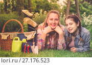 Купить «smiling young woman and girl with gardening tools in outdoors», фото № 27176523, снято 18 апреля 2017 г. (c) Яков Филимонов / Фотобанк Лори