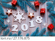 Купить «Happy New Year 2018 background with 2017 figures, Christmas toys, blue fir tree branches. New Year 2018 composition», фото № 27176875, снято 29 ноября 2016 г. (c) Зезелина Марина / Фотобанк Лори