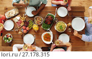 Купить «group of people eating and drinking wine at table», видеоролик № 27178315, снято 15 сентября 2019 г. (c) Syda Productions / Фотобанк Лори