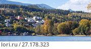 Город Зебоден (Seeboden) на берегу альпийского озера Мильштеттер осенью, штат Каринтия, Австрия (2017 год). Стоковое фото, фотограф Bala-Kate / Фотобанк Лори