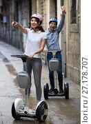 Купить «Young couple driving segways», фото № 27178707, снято 18 января 2019 г. (c) Яков Филимонов / Фотобанк Лори