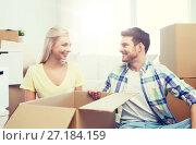 Купить «smiling couple with many boxes moving to new home», фото № 27184159, снято 25 февраля 2016 г. (c) Syda Productions / Фотобанк Лори