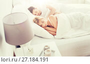 Купить «happy couple sleeping in bed at home», фото № 27184191, снято 25 февраля 2016 г. (c) Syda Productions / Фотобанк Лори