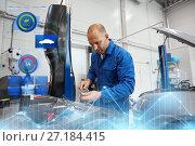 Купить «mechanic man with wrench repairing car at workshop», фото № 27184415, снято 1 июля 2016 г. (c) Syda Productions / Фотобанк Лори