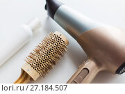 Купить «hairdryer, brush and hot styling hair spray», фото № 27184507, снято 12 апреля 2017 г. (c) Syda Productions / Фотобанк Лори